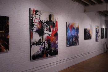 The large scale collaborative pieces hang at the gallery